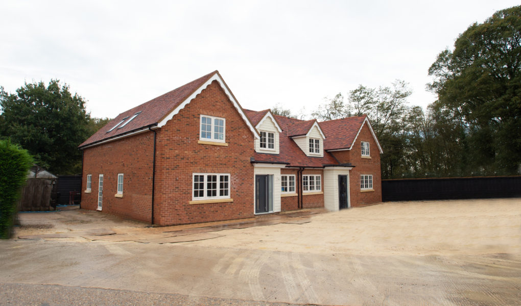 Two luxury new build houses on an old farmhouse site in Cheshunt